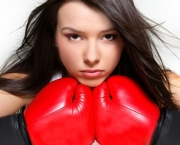 close up portrait of female boxer over white
